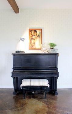 Matte black piano