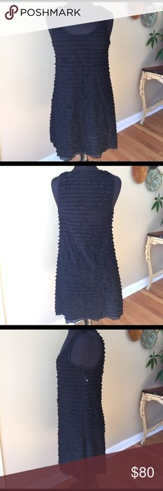 """Free People Black Ruffle Midi Dress Size Med NWOT Free People Black Ruffle Midi Dress. Size Medium. Beautiful and """"Rare"""" . Slightly Fitted. Material does stretch. This Dress flatters you in all the right places. Rows of tiny ruffles adorns the Dress. Purchased for a wedding, never worn. Can be dressed up or down. 🚫Trades. Please ask all questions prior to buying. Free People Dresses Midi"""