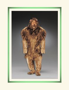 "We are pleased to announce the addition of the ""Cowardly Lion™"" to our exciting series based on the classic 1939 motion picture masterpiece The Wizard of Oz™ Oz Series, Wizard Of Oz 1939, Kids Book Series, Cowardly Lion, Tin Man, Yellow Brick Road, The Best Films, Bear Doll, Felt Dolls"