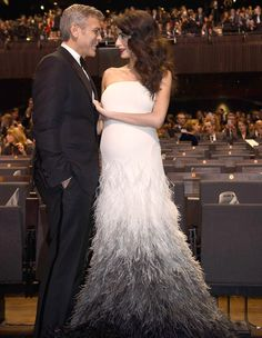 """Amal Clooney was on hand Friday in Paris to support her husband George Clooney at the Césars Awards, where the actor was presented with a career award as """"the most charismatic actor of his generation.love this gorgeous couple. Fashion Couple, Love Fashion, Amal Clooney George Clooney, Celebrity Couples, Celebrity Style, Romantic Paris, Hollywood, Feather Dress, Mode Style"""