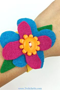 No Trolls Dress Up would be complete without a Hug Time Bracelet! Simple to make and the perfect accessory crafts for your Trolls Costume! Perfect for pretend play or makes a great Trolls Birthday Party Idea!