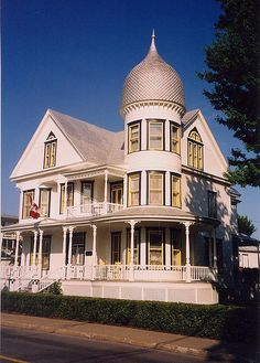Queen Anne Victorian with turret.
