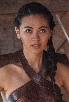"""Nymeria Sand, often called """"Nym"""" for short, is a recurring character in the fifth and sixth seasons, though she had already been alluded to in Season 4. She is played by Jessica Henwick and debuts in """"Sons of the Harpy"""". Nymeria Sand is the second of the eight bastard daughters of Prince Oberyn Martell, known as the """"Sand Snakes"""". Nymeria's mother was an Eastern noblewoman, who taught her how to use a whip in combat, but who later died in battle. Nymeria became very skilled with using her 8.... Music Tv, Music Stuff, Tv Actors, Actors & Actresses, Queen Cersei, Jessica Henwick, Game Of Thrones, Eddard Stark, High Cheekbones"""