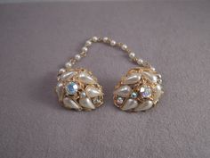Aurora Borealis and Faux Pearl Sweater Clip 1950-60s by thejeweledbear on Etsy