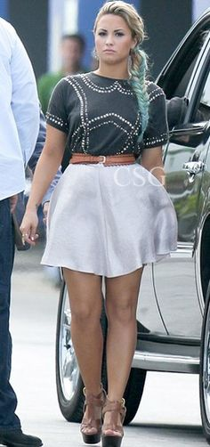 Seen on Celebrity Style Guide: Demi Lovato wore this Topshop Bead Placement Tee, although her version was altered slightly to the one which is available, while filming the X Factor bootcamp in Miami, July 23, 2012