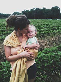 Babywearing while strawberry picking. #ergobaby #idealmothersday #babywearing