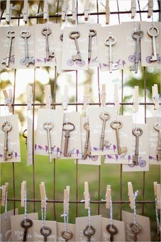 vintage key escort cards - and put little vintage locks at the table to go with their keys! Perfect idea for our wedding since Tad always says I hold the key to his heart. No one was ever able to get him to open up like I have.