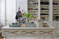 creamy delicious dressing room w/fantastic wallpaper, beautiful boxes stacked neatly, glass topped island & custom shoe storage♥