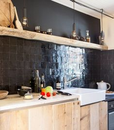 Credenza in black zellige. Worktop in raw travertine. The cupboard doors are washed, sanded, brushed formwork boards. Kitchen Built Ins, Kitchen Pantry, Kitchen Dining, Kitchen Decor, Kitchen Island, Modern Kitchen Interiors, Modern Craftsman, Kitchen Cabinet Remodel, Cabin Kitchens