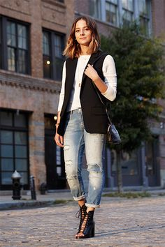 "Her Go-To Style: The Sleeveless Blazer  ""I have a lot of sleeveless blazers, like this one, and I also have a vest that's a little bit longer but flowy. They're cool to throw over anything — a dress, a skirt and top, boyfriend jeans. You can do something sleeveless underneath or something with sleeves. You can definitely dress them up, too: Swap the jeans for an A-line or miniskirt, add a red lip, snazz up the accessories, maybe swap your work bag for a clutch."""