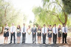 grey and yellow wedding party but with yellow flowers and guys with vests and rolled up sleeves :)