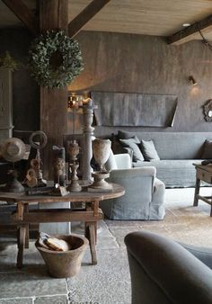 This wood & stone living room filled w/ neutral colors is the epitome of rustic design. From the elegant yet simple table to the wreath, we adore everything about this interior! Dark Interiors, Rustic Interiors, Rustic Style, Rustic Decor, Rustic Design, House Of Pain, Deco Champetre, Interior Decorating, Interior Design
