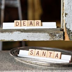 Spell out a Yuletide message. Score big with this little idea—Scrabble tiles offer a fun, low-key way to say what's on your mind. Paint the standard holders white to really make your words pop. You can even use them as placecards for Christm  as Eve dinner.