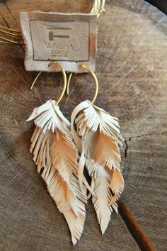 Small Leather Feather Long Bone Earrings.
