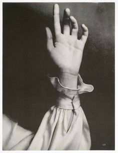 Richard Avedon, [Hand with long sleeved blouse in front of black hair], ca. 1968