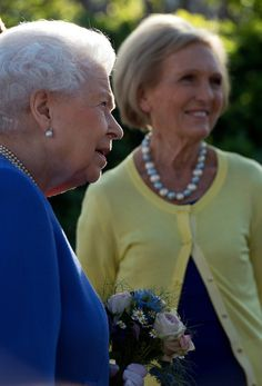 Queen Elizabeth II Photos Photos - Queen Elizabeth II meets Mary Berry at the BBC Radio 2 Garden at the RHS Chelsea Flower Show press day at Royal Hospital Chelsea on May 22, 2017 in London, England. The prestigious Chelsea Flower Show, held annually since 1913 in the Royal Hospital Chelsea grounds, is open to the public from the 23rd to the 27th of May, 2017. - Members Of The Royal Family Visit The RHS Chelsea Flower Show