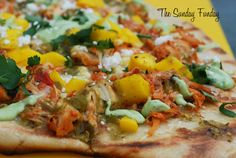 Grilled Chipotle PIzza with Chipotle chicken tinga, mango, sweet corn, and avocado crema.
