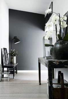 Grayscale hallways with console tables... chic!