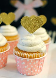pink polka dots cupcakes with gold glitter heart cupcake toppers for a sparkling pink baby shower