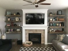 Rustic living room! Barnwood floating shelves + shiplap fireplace + books and decor = home sweet home! ❤️❤️❤️ My husband did the shiplap and shelves and I did the decor!