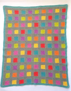 This stunning mitered square blanket will add a pop of colour to your home. The textured stitches and mitered squares create the illusion of a 3D effect making it visually interesting and very touchable.  Constructed using a nifty join as you go method that will ensure your joins are beautifully neat and with the added bonus of no sewing up all those little squares later. This project is easily picked up to do just one square here and there or it can also be totally addictive and hard to put…