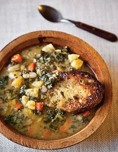 Tuscan Bean Soup l Saveur l  Olive oil is used 3 ways: for sautéing garlic, rubbing on the toast, and finishing the soup. (Add shaved parm and a ramekin of chili flakes.)
