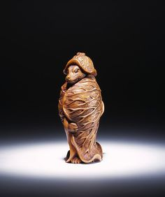 Netsuke        Place of origin:        Japan (made)      Date:        19th century (made)      Artist/Maker:        unknown (maker)      Materials and Techniques:        Carved boxwood      Credit Line:        Salting Bequest      Museum number:        A.919-1910