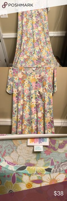 Lularoe Carly Watercolor print HTF Beautiful Watercolor print in pastel colors . Throw a darker matching sarah over it and wear it thru fall or put it in your closet till spring. Lowest price of the season for new. Only tried on and hung in closet . LuLaRoe Dresses High Low