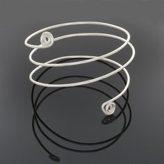 This bangle bracelet wraps twice up the arm and has spirals on each end. It's like wearing 3 bracelets in one. Fits small or medium wrists. Properties are: Silver: calms and brings balance Beaded Wrap Bracelets, Bangle Bracelets, Bangles, Boho Jewelry, Handmade Jewelry, Snake Bracelet, Purple Amethyst, Sterling Silver Bracelets, Spirals