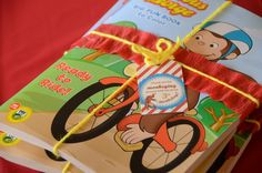 favors for Curious George Party/ Curious George coloring books from Dollar Tree wrapped in yarn with tag