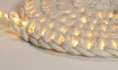 Crochet around a rope light to make an outdoor rug
