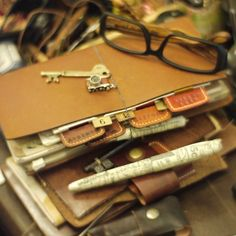Traveler's Notebook This photo makes me realise what it is I love about Midori notebooks; they're so very steampunk looking!-SR