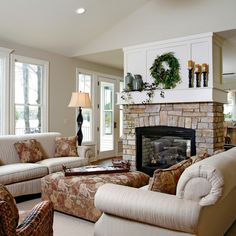 Fireplace in the middle of the room which is shared by the family room and the kitchen