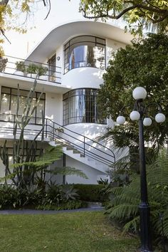 Wyldefel Gardens was built in 1934 and designed by architect John Brogan. In high Continental Moderne style, it is in the community of 22 identical apartments, with curved bent glass windows and beautifully rendered walls and the most exquisite, 90-year-old manicured #garden. Looks like an old cruise liner
