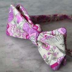 Pink and Purple Berry Paisley Bow Tie. Beautiful elegant soft pink, purple, magenta and white paisley makes a charming tie. This beautiful soft cotton makes a beautiful and elegant bow tie. This darling tie is perfect for a wedding or a fun addition to any outfit. Made of top quality designer cotton. It will also hold up to lots of wear. Stylish bow tie for a true gentleman. Available in different styles to fit any budget. Boys clip on bow ties are darling and easy to wear. A metal clip...