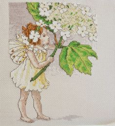 A gorgeous finish by Crystal! She stitched this pretty Flower Fairies design of The Guelder Rose Fairy which was our cover star project, way back in issue 58 (May 2002!) of The World of Cross Stitching magazine ;)