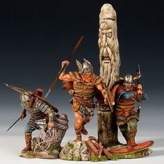 A trio of Viking warrior toy soldiers.