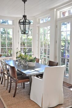 love the white with the natural wood & jute tones. Great way to in a room with lots of windows not to break up the view