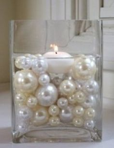 Pearls in glass candle votive art deco roaring great gatsby party theme wedding shower Not a fan of floating candles, but this looks ok.a place to mix the golds. 30th Wedding Anniversary, Anniversary Parties, Pearl Anniversary, 30th Anniversary Gifts For Parents, 30 Year Anniversary, Anniversary Decorations, Inexpensive Wedding Centerpieces, Dream Wedding, Wedding Day