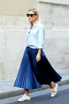 simple....a shirt.....a blue pleated skirt and a pair of sneakers...