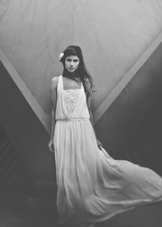 white, lacey, flowing, long, swooping neckline, dress. grey scale picture. le jupon