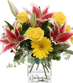 A sweet arrangement of stargazer lilies with yellow roses and gerbera daisies in a nice cube vase. Exotic Flowers, Yellow Flowers, Beautiful Flowers, Pink Yellow, Spring Flowers, Get Well Soon Flowers, Yellow Flower Arrangements, Anniversary Flowers, Wedding Anniversary