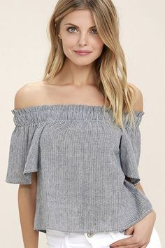 Set out to sea, or out for brunch in the Seas the Day Blue and White Striped Off-the-Shoulder Top! A ruffled, elasticized neckline tops this nautical inspired off-the-shoulder top composed of blue and white striped woven cotton. Cropped bodice and short sleeves.