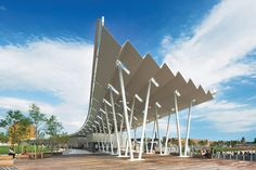 Weiss/Manfredi consolidated various park functions—bathrooms, storage, concession stand, shade structure—into one large curving pavilion that echoes the ...