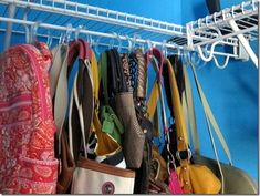 Use Shower Curtain Hangers to Organize Purses or scarves.  I did this tonight with my scarves....so organized now!!!!  =)