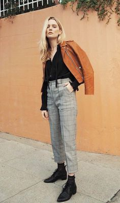 Photo via: Meganadelaide Sometimes an outfit feels so good you just don't want to take it off. This look is one of them. Megan paired a camel-colored leather jacket with a silk black shirt, checked tr
