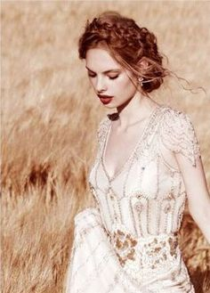 This is another look that has been inspirational as I plan my wedding look.  The hair is too bohemian for my taste, the lip is too bold, and my dress is far simpler, but I still find this beautiful.
