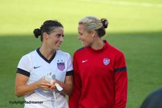 Ali Krieger (left) and Ashlyn Harris (right)
