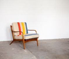 HUDSON-BAY-CHAIR - this chair has been recovered with a vintage Hudson Blanket. Cute idea. U could do this with a Pendleton or other wool blanket.
