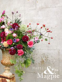 Martin  the Magpie Large autumn urn arrangement, perfect for a wedding. Roses, rose hips, dahlias, cosmos, vines. home grown from our walled garden